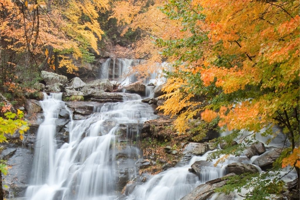 Bastion Falls surrounded by fall foliage in the Catskills region of New York.