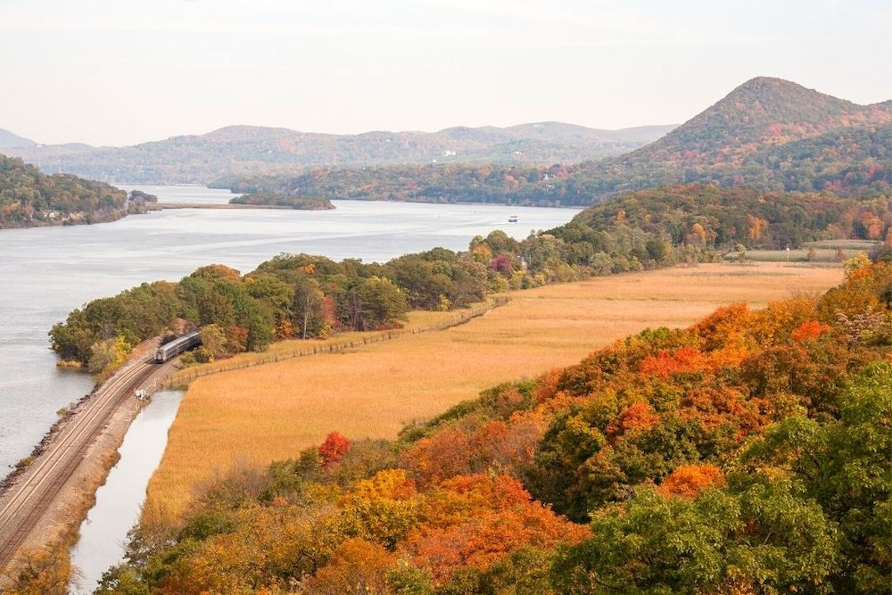 A panoramic views of the Hudson River and the surrounding mountains with beautiful, fall foliage.