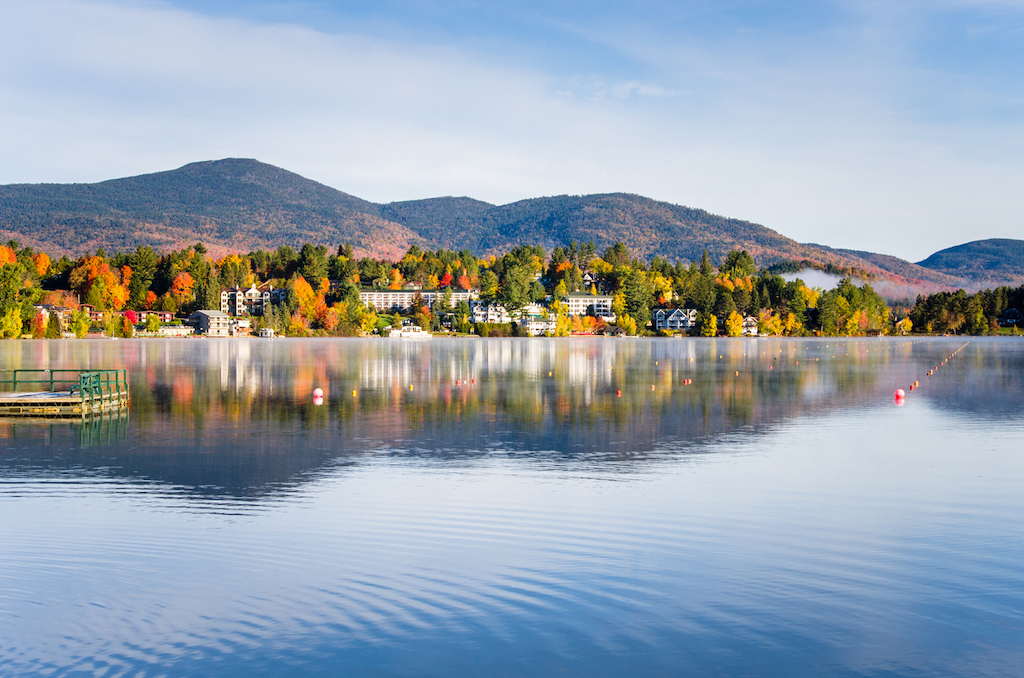 View of the Mountain Village of Lake Placid from a Foggy Mirror Lake at Sunrise