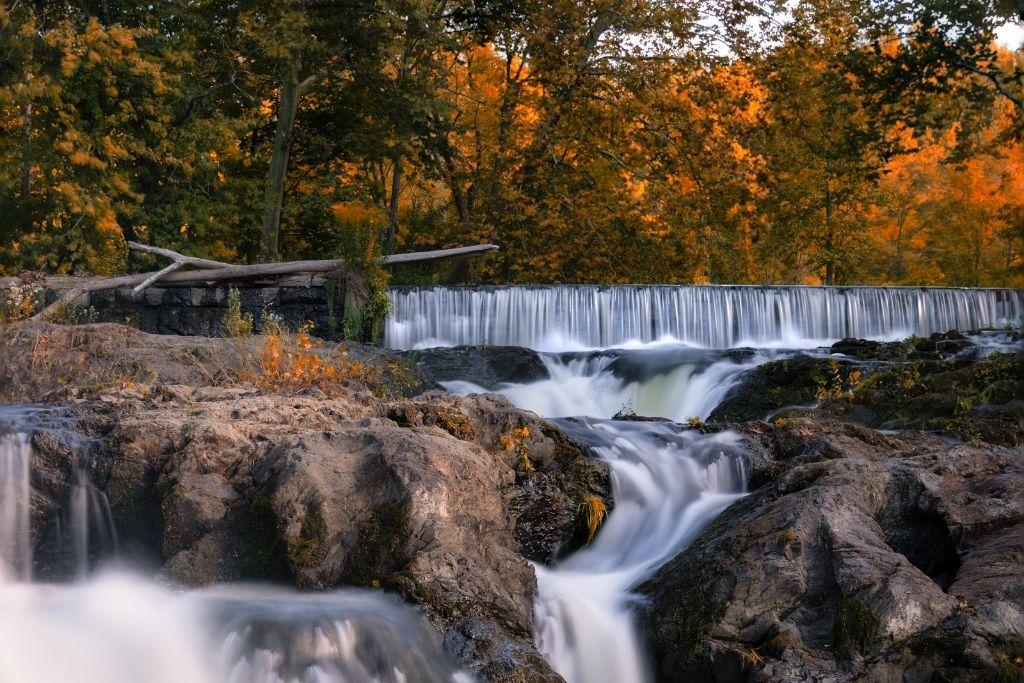 Waterfall in Madam brett park surrounded by stunning fall folaige.