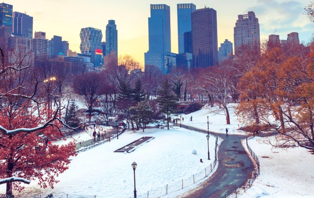 Snow on the ground during winter at sunset in Central Park.