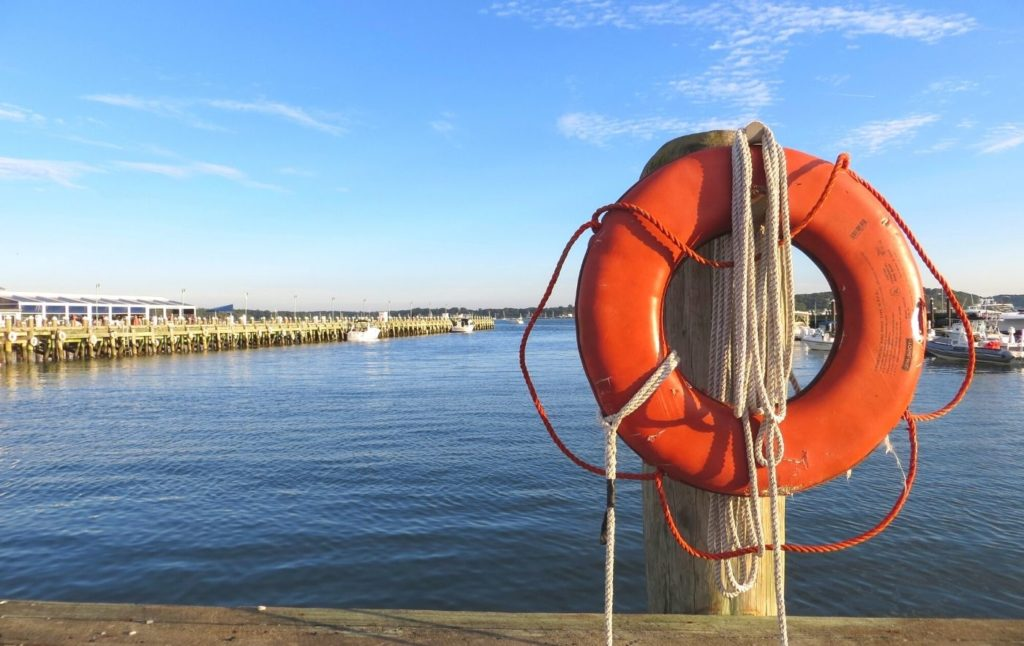 Orange lifesaver at Greenport Harbor in Long Island New York