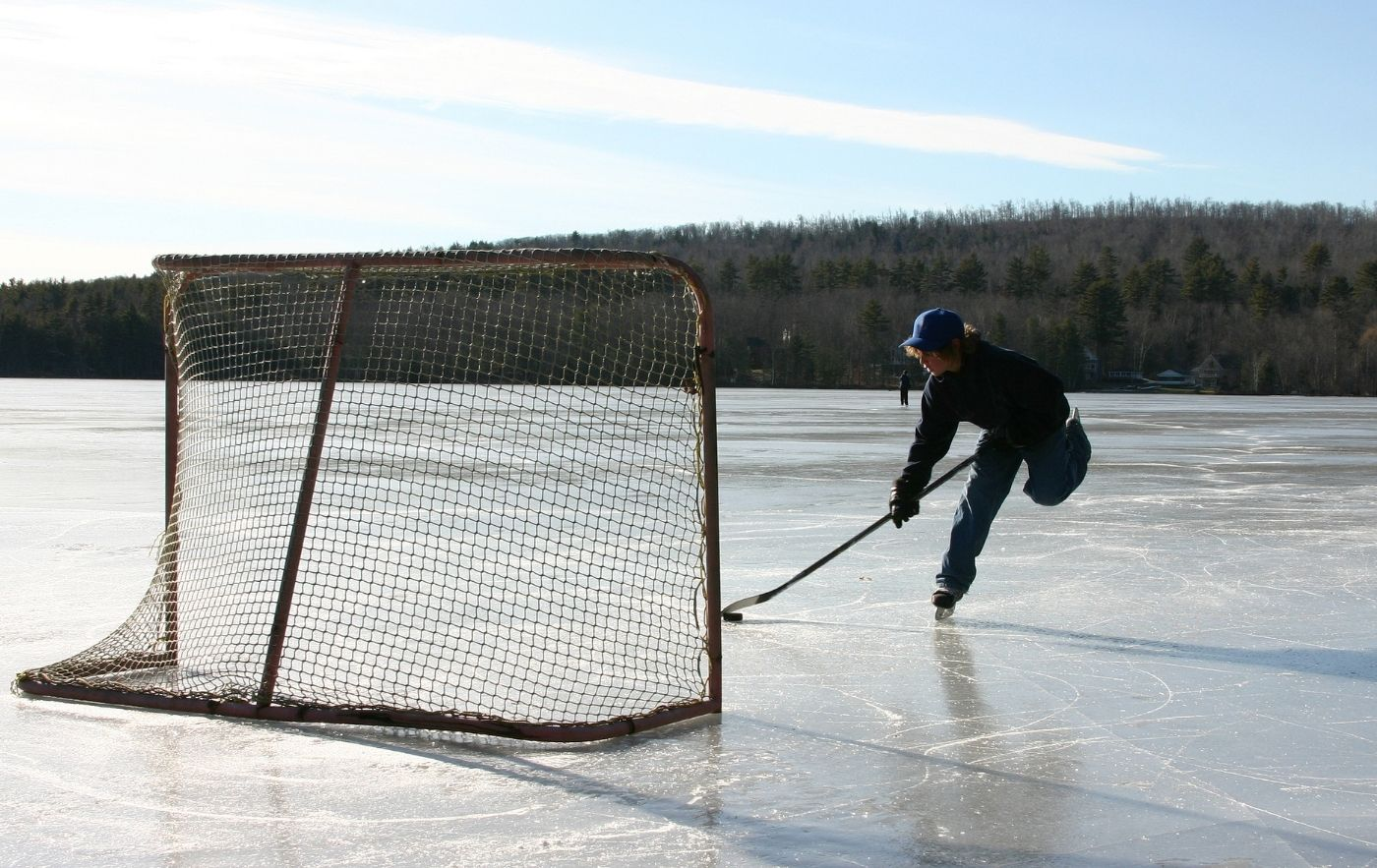 Skater playing hockey on a pond in upstate NY.