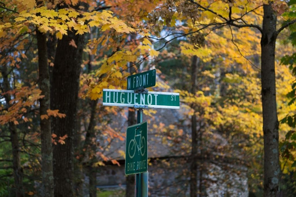 Green street sign for Huguenot Street in New Paltz, NY.
