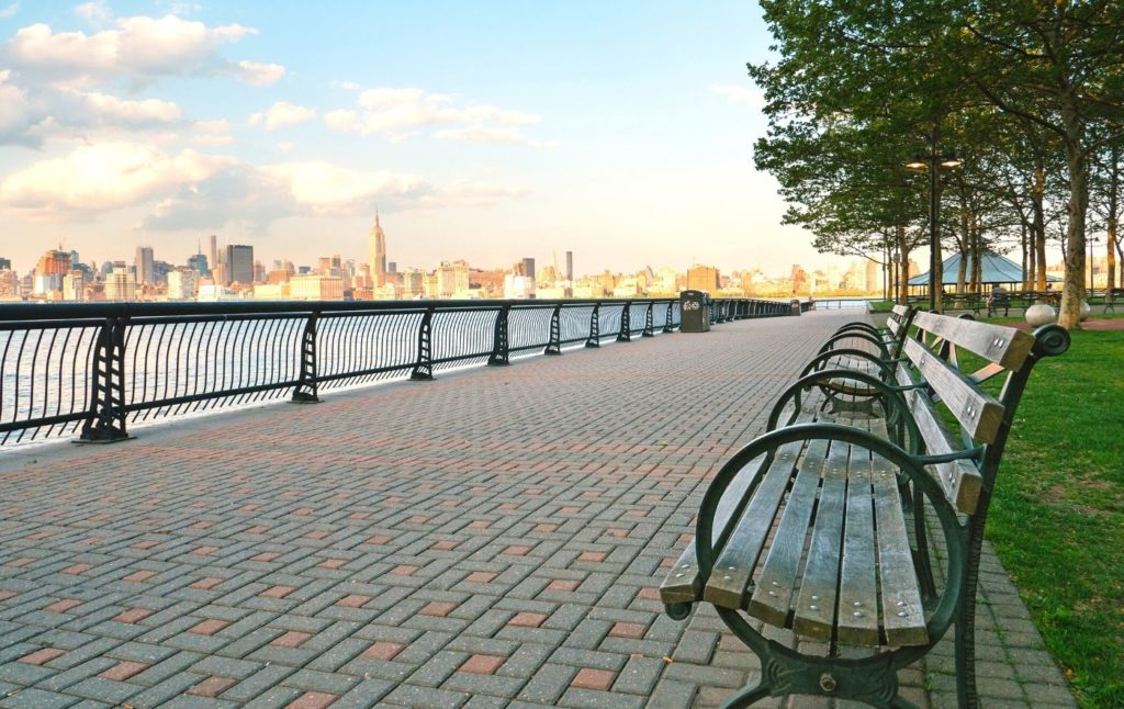 View of the Manhattan skyline from a park on the Hudson River.