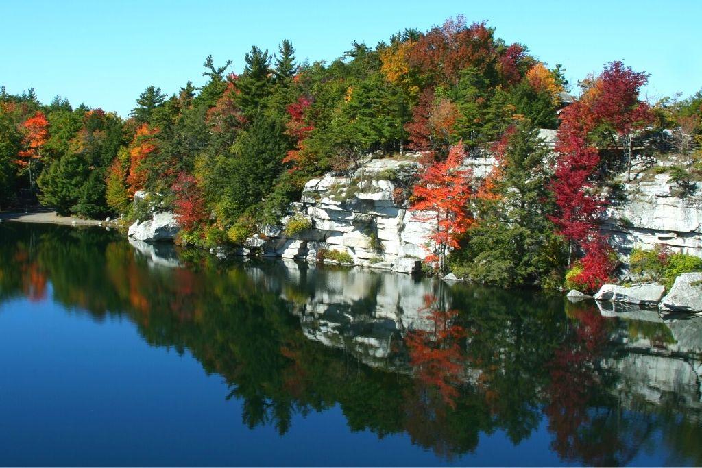 Stunning fall foliage along a lake Minnewaska State Park near New Paltz.
