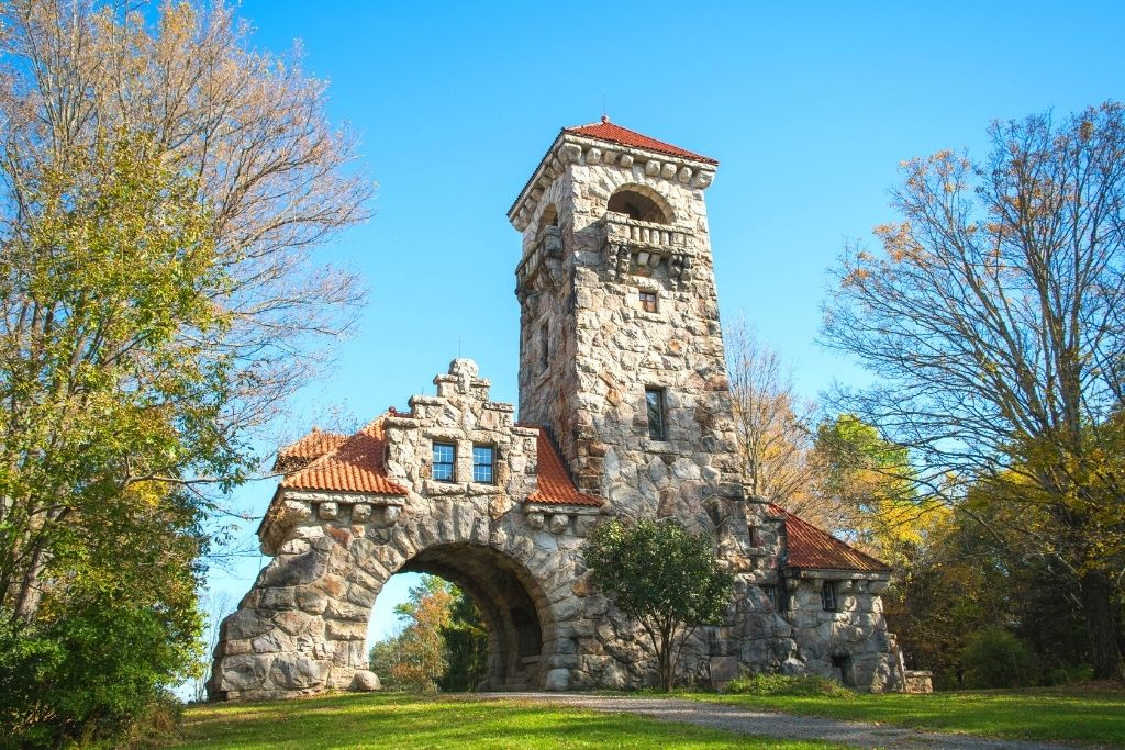 The elaborate stone facade of the historic Mohonk Testimonial Gateway, one of the best things to do in New Paltz, NY.