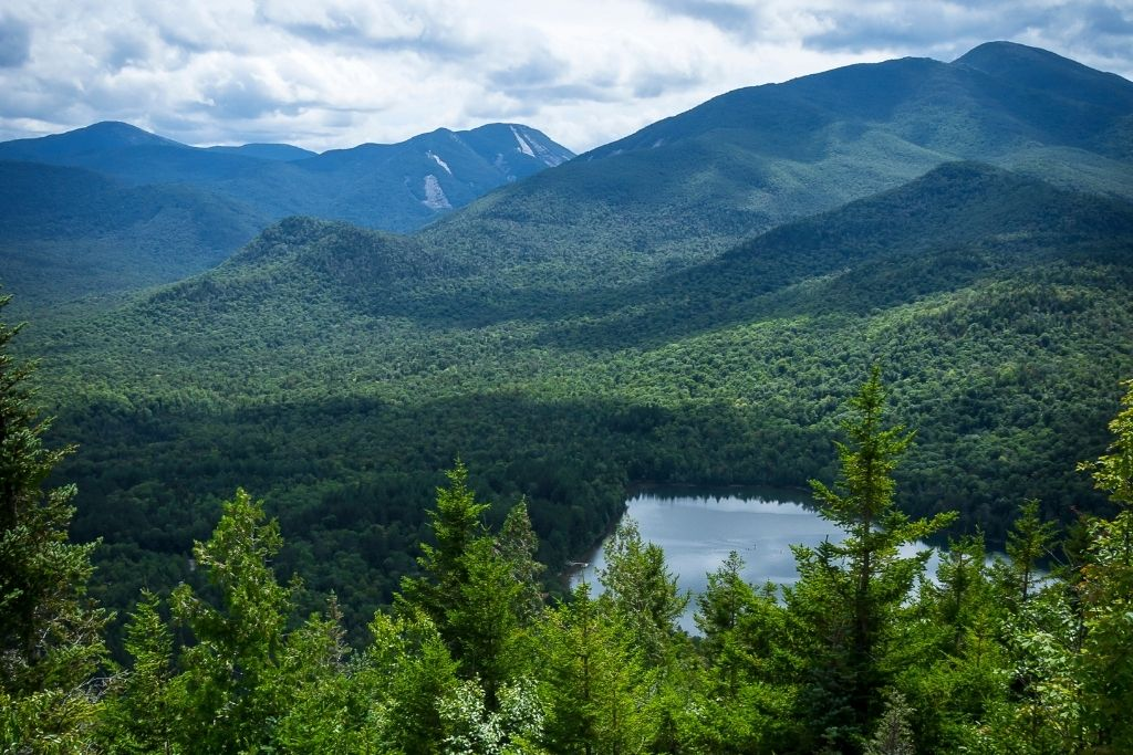 Panoramic view of the Adirondacks from a lookout on Mount Jo, one of the best things to do in Lake Placid, NY.