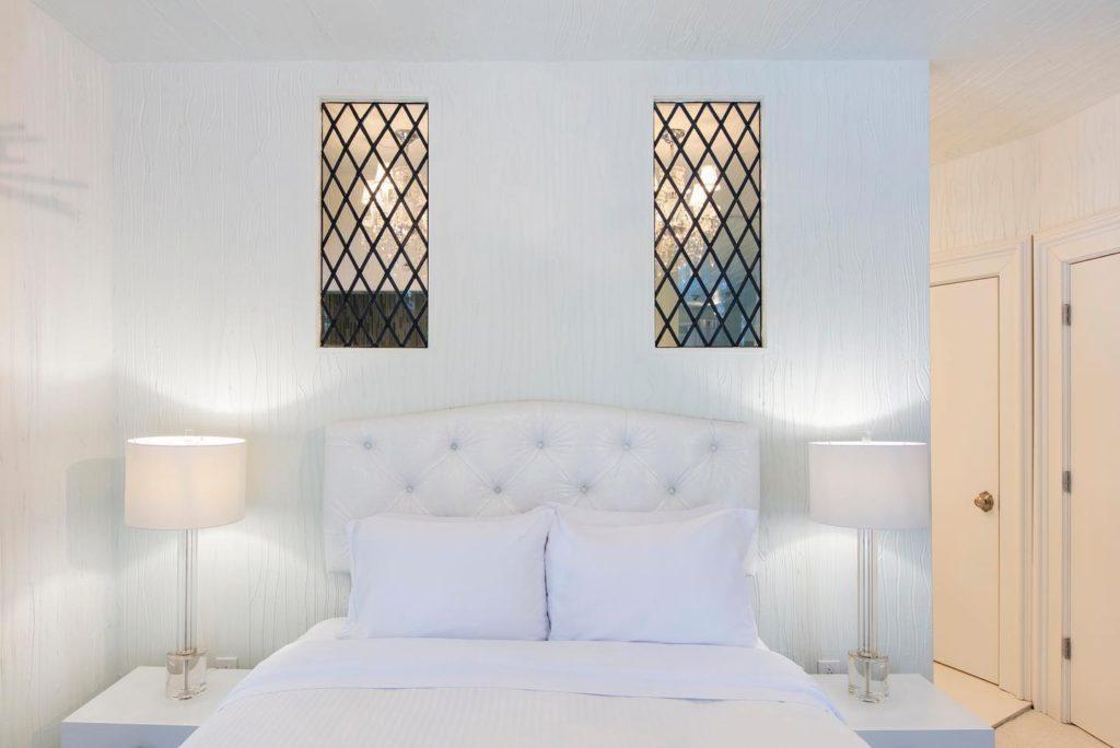 Sleek white room inside the Roxbury Hotel in the Catskills.