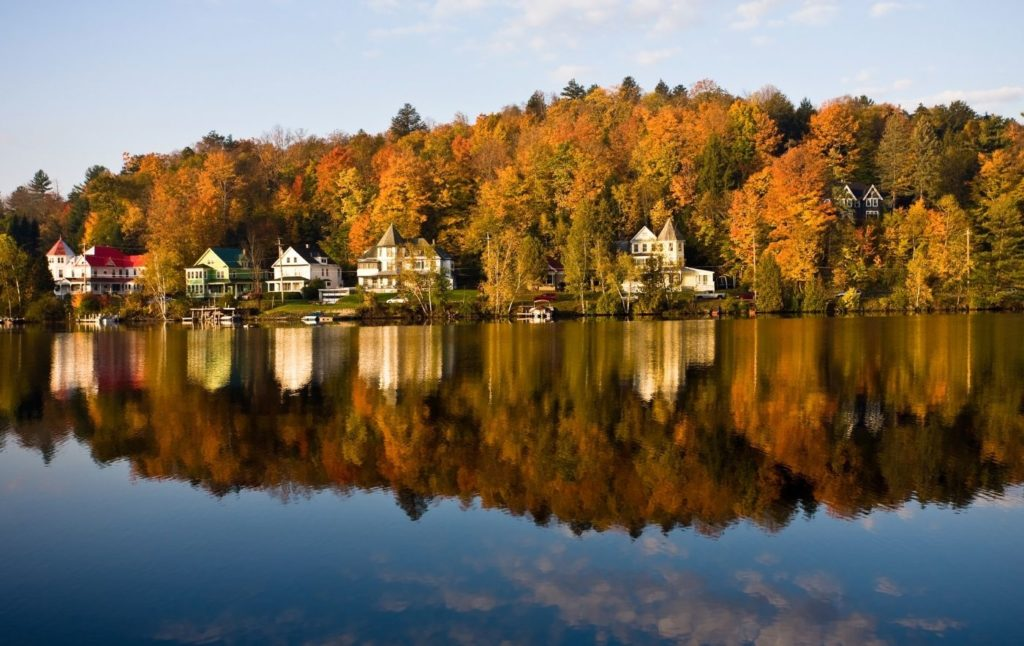 Fall foliage and charming houses on Saranac Lake, one fo the east small towns in Upstate New York