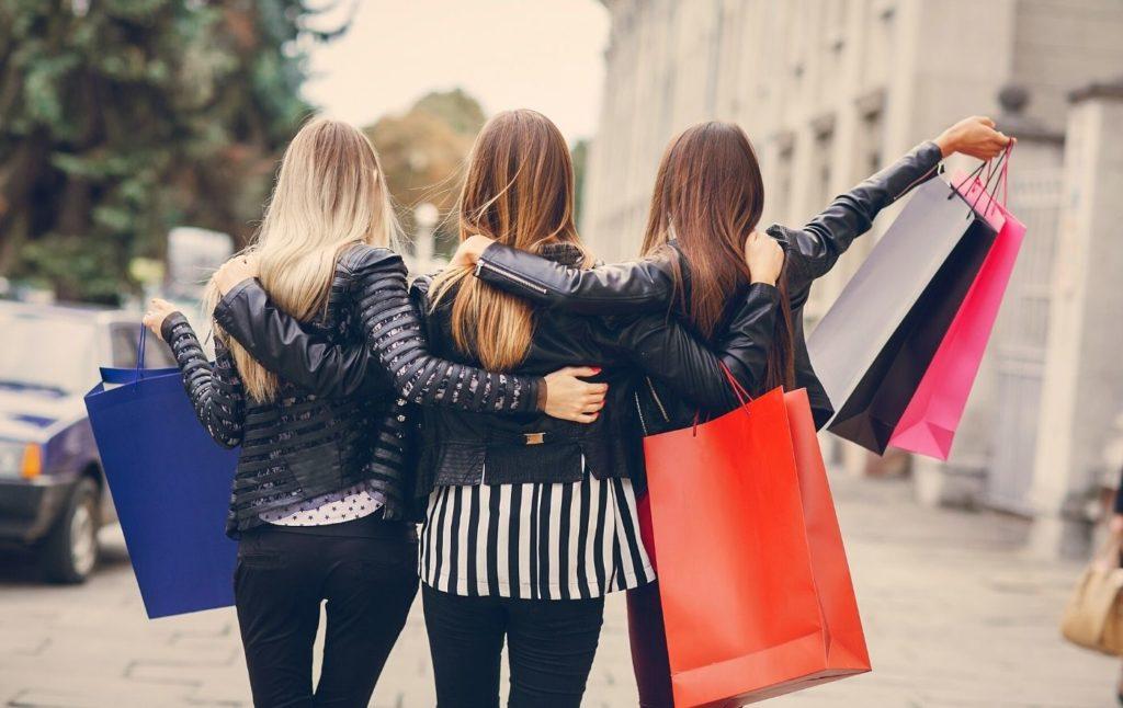 Three women shopping in New York City.