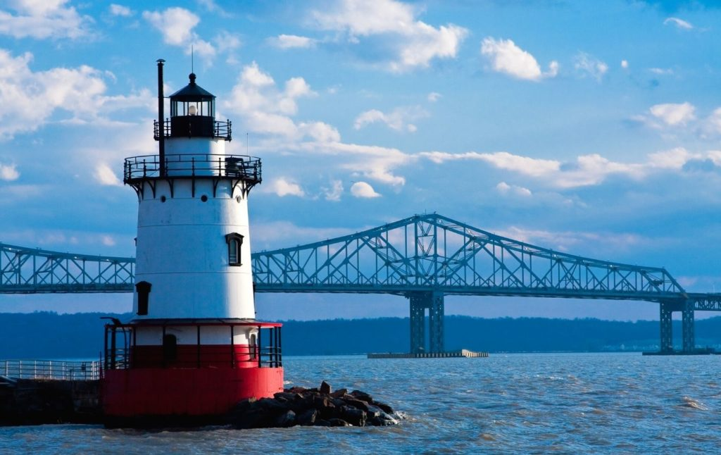 Tarrytown Lighthouse with the Tappan Zee Bridge in the background in one of the best small towns in New York.