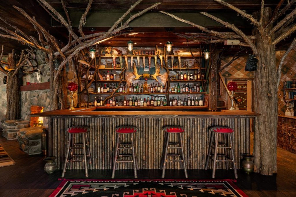 Chic, Adirondack-style bar of Urban Cowboy Lodge. One of the best winter weekend getaways from NYC.
