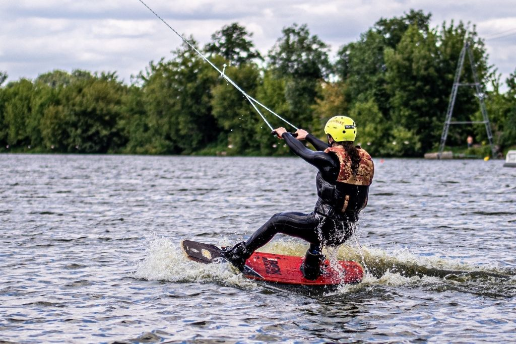 Man wakeboarding and being pulled by a rope.