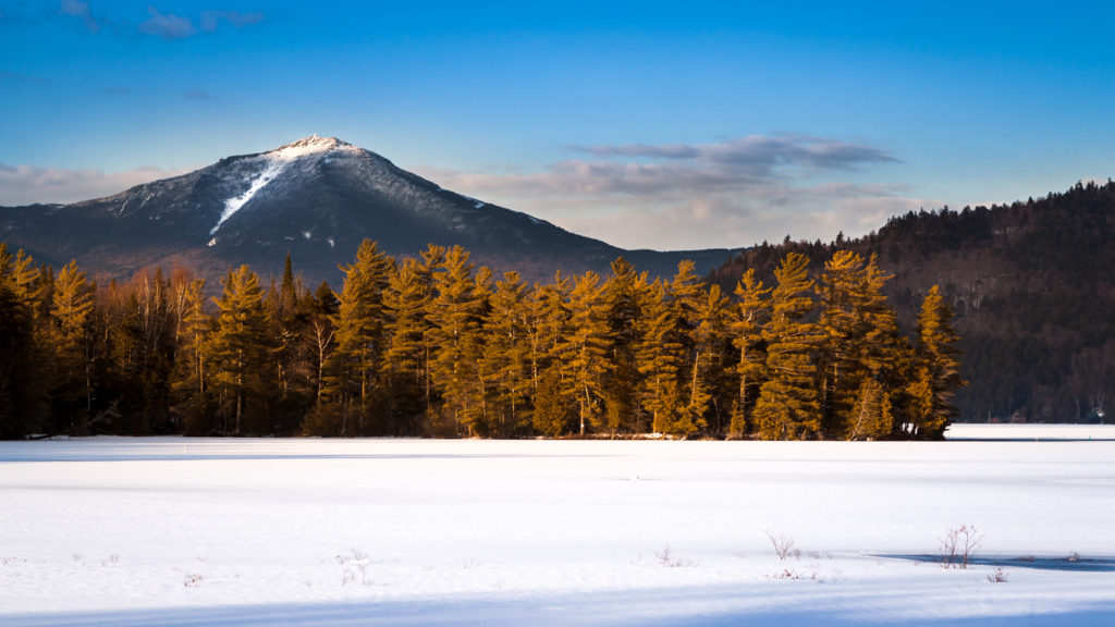 Whiteface mountain peak viewed from the frozen Paradox Bay in Lake Placid, Upstate New York