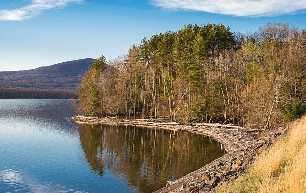 View of Ashokan Reservoir in the Catskills at sunset, one of the best things to do in Woodstock NY.
