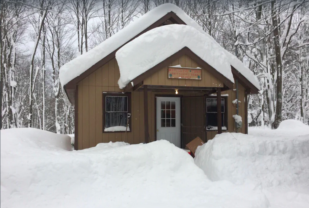 Cozy cabin covered in snow in the Finger Lakes of New York.
