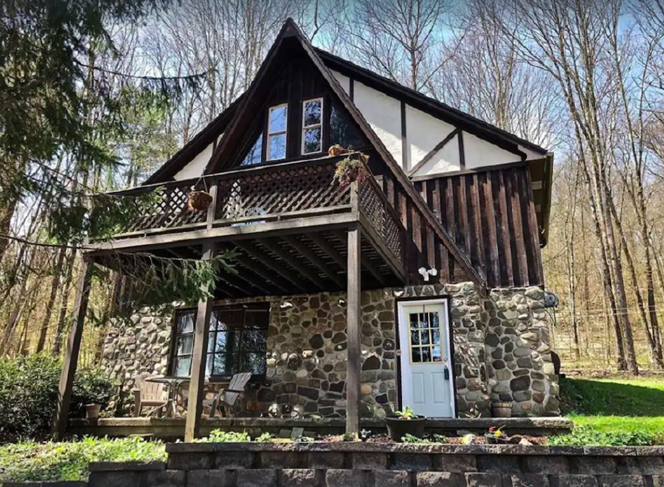Wood and stone exterior of one of the best cabin getaways in New York near Binghamton.