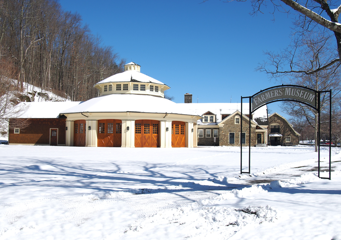 Cooperstown Farmers Museum covered in show and the Empire Carousel.