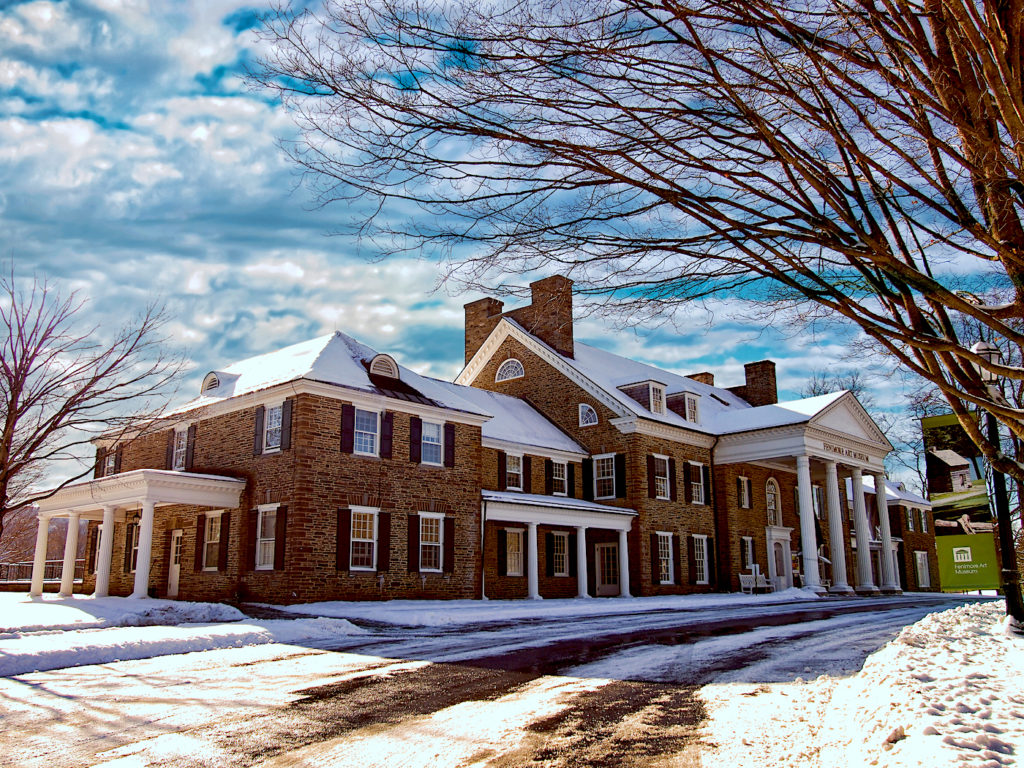 The exterior of the Fenimore Art Museum is covered in snow. One of the best things to do in Cooperstown NY.