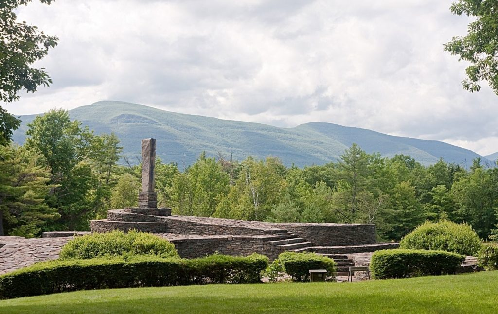 View of the Opus 40 sculpture park with stunning green mountains in the background.