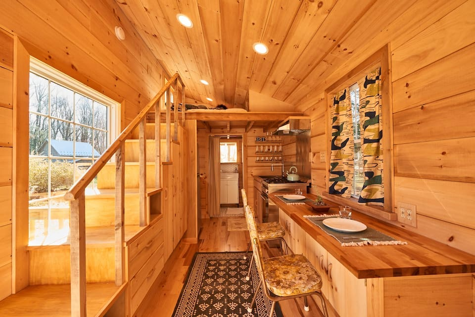 Modern wooden interior of the Outlier Inn Tiny House in New York on a Farm in the Upstate Catskills.