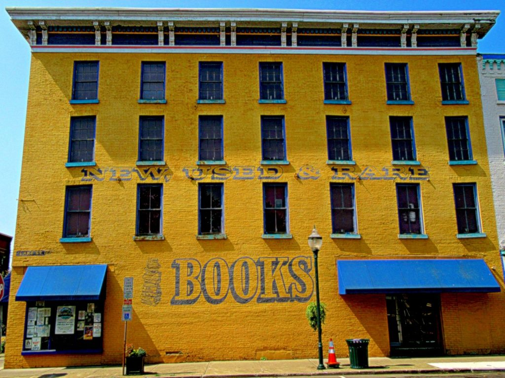 The vibrant yellow exterior of Riverow Bookshop, one of the best things to do in Owego New York.