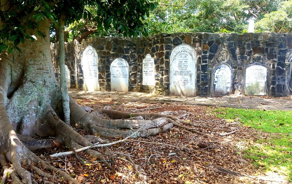 Historic gravestones under a tree in the Sleepy Hollow Cemetery. One of the best things to do in Sleepy Hollow NY.