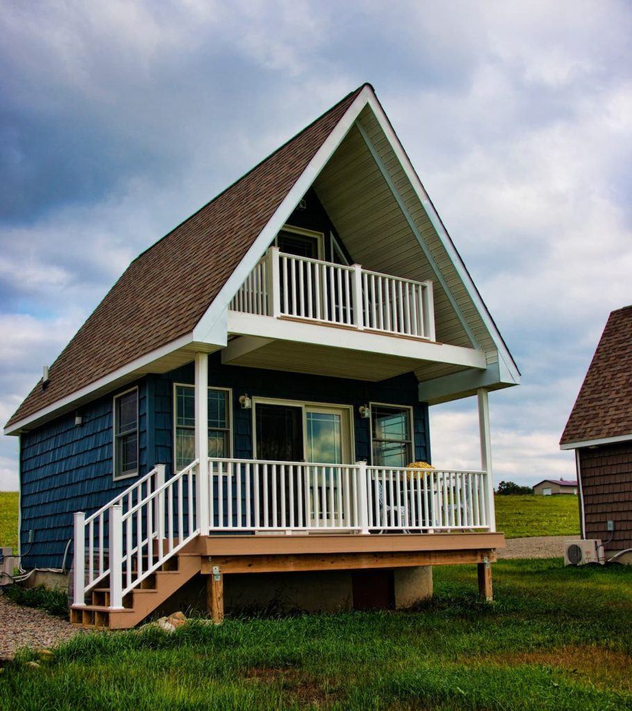 front porch and wood-panneled exterior of this tiny house in the finger lakes.
