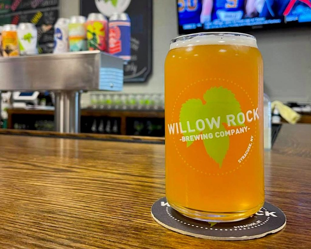 Light beer in a glass on the bar at Willow Rock Brewing Company.