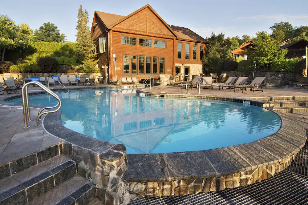 The stunning outdoor pool at The Lodges at Cresthaven in Lake George New York. One of the best romantic getaways in upstate New York.